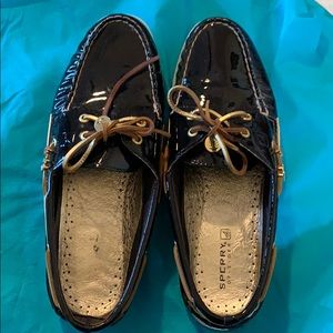 Sperry patent leather slip on shoes in a size 10